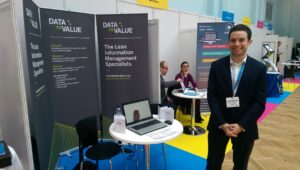 Matthew Richardson at Data to Value stall, London Info International
